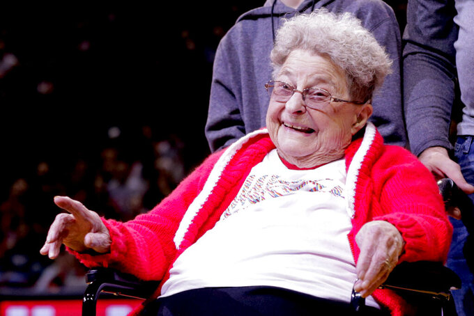 98-year-old Florence Dalby smiles at halftime of an NCAA college basketball game between Ohio State and Nebraska in Lincoln, Neb., Saturday, Jan. 26, 2019. Dalby is a University of Nebraska Lincoln graduate and has had a men's basketball season ticket for more than 80 years. Dalby loves Nebraska as much today as she did when she first started going to games in 1939. The Cornhuskers honored her during their Coaches Vs. Cancer game against Ohio State. (AP Photo/Nati Harnik)