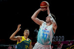 Slovenia's Luka Doncic (77) shoots against Australia's Dante Exum (11) during the men's bronze medal basketball game at the 2020 Summer Olympics, Saturday, Aug. 7, 2021, in Tokyo, Japan. (AP Photo/Charlie Neibergall)