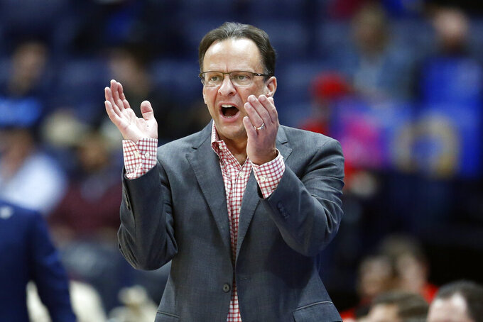 Georgia head coach Tom Crean yells to his players in the first half of an NCAA college basketball game against Mississippi in the Southeastern Conference Tournament Wednesday, March 11, 2020, in Nashville, Tenn. (AP Photo/Mark Humphrey)