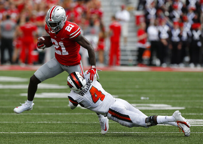 Ohio State receiver Parris Campbell, left, escapes the grasp of Oregon State defensive back Dwayne Williams during the second half of an NCAA college football game Saturday, Sept. 1, 2018, in Columbus, Ohio. Ohio State beat Oregon State 77-31. (AP Photo/Jay LaPrete)