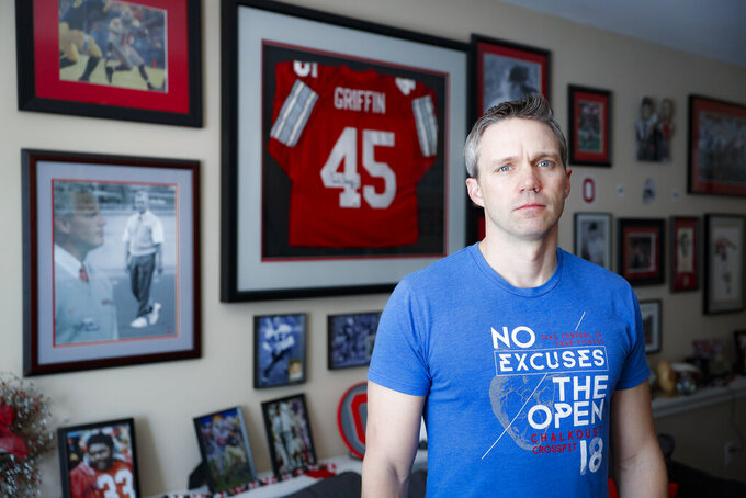 Brian Garrett stands for a portrait at his home, Saturday, May 18, 2019, in Powell. Ohio. Former nursing student Brian Garrett said he worked for a short time at an off-campus clinic Dr. Richard Strauss opened after he was ousted at Ohio State in the late 1990s. But Garrett quit after witnessing abuse by Strauss and then experiencing it himself. (AP Photo/John Minchillo)