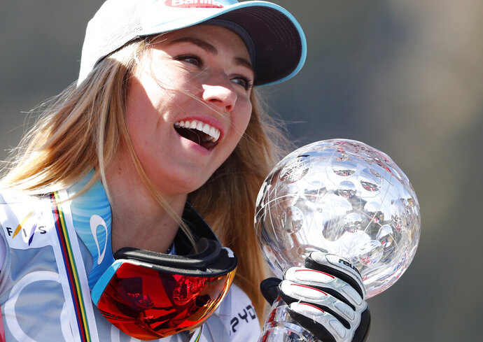 United States' Mikaela Shiffrin holds the women's World Cup super G discipline trophy, at the alpine ski World Cup finals, in Soldeu, Andorra, Thursday, March 14, 2019. (AP Photo/Gabriele Facciotti)