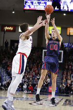 Saint Mary's guard Tanner Krebs (0) shoots over Gonzaga forward Corey Kispert during the first half of an NCAA college basketball game in Spokane, Wash., Saturday, Feb. 9, 2019. (AP Photo/Young Kwak)