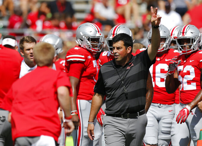Ohio State acting head coach Ryan Day watches warm-ups before the start of their NCAA college football game against Oregon State Saturday, Sept. 1, 2018, in Columbus, Ohio. (AP Photo/Jay LaPrete)