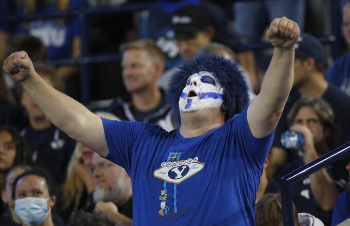A BYU fan celebrates in the first half of an NCAA college football game against South Florida Saturday, Sept. 25, 2021, in Provo, Utah. (AP Photo/George Frey)