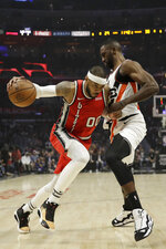 Portland Trail Blazers' Carmelo Anthony, left, is defended by Los Angeles Clippers' Patrick Patterson during the first half of an NBA basketball game Tuesday, Dec. 3, 2019, in Los Angeles. (AP Photo/Marcio Jose Sanchez)