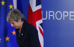 FILE - In this Friday, March 22, 2019 file photo, British Prime Minister Theresa May leaves after addressing a media conference at an EU summit in Brussels. May is off to Brussels to ask for a delay to Britain's departure from the European Union. EU leaders want to know she has a plan to break the U.K.'s political impasse, but talks between the government and its political opponents over a compromise have yet to bear fruit. Meanwhile, Britain is scheduled to leave the EU in two days on April 12, 2019. (AP Photo/Frank Augstein, File)