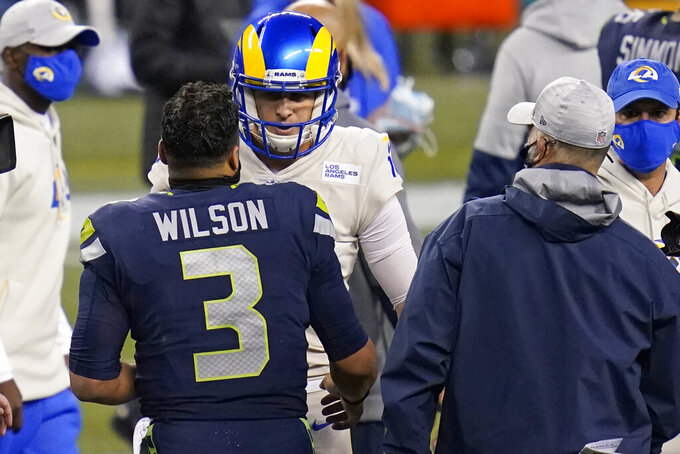 Seattle Seahawks quarterback Russell Wilson (3) talks with Los Angeles Rams quarterback Jared Goff (16) after an NFL football game, Sunday, Dec. 27, 2020, in Seattle. The Seahawks won 20-9. (AP Photo/Elaine Thompson)