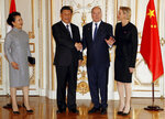From left to right, The wife of Chinese President Xi Jinping, Chinese President Xi Jinping, Prince Albert II of Monaco and his wife Princess Charlene pose for photographers at Monaco Palace, Sunday, March 24, 2019. Xi is paying the first state visit by a Chinese president to the tiny Mediterranean principality of Monaco on Sunday. (Eric Gaillard/Pool Photo via AP)