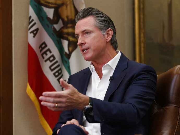 FILE - In this Oct. 8, 2019, file photo, California Gov. Gavin Newsom speaks during an interview in Sacramento, Calif. Newsom said on Wednesday, Jan. 8, 2020, that he is seeking $750 million to help pay rent for people facing homelessness, among other purposes, in the most populous state's latest attempt to fight what he called a national crisis. (AP Photo/Rich Pedroncelli, File)