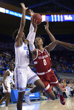 Stanford forward KZ Okpala, right, shoots as UCLA guard Chris Smith defends during the first half of an NCAA college basketball game Thursday, Jan. 3, 2019, in Los Angeles. (AP Photo/Mark J. Terrill)