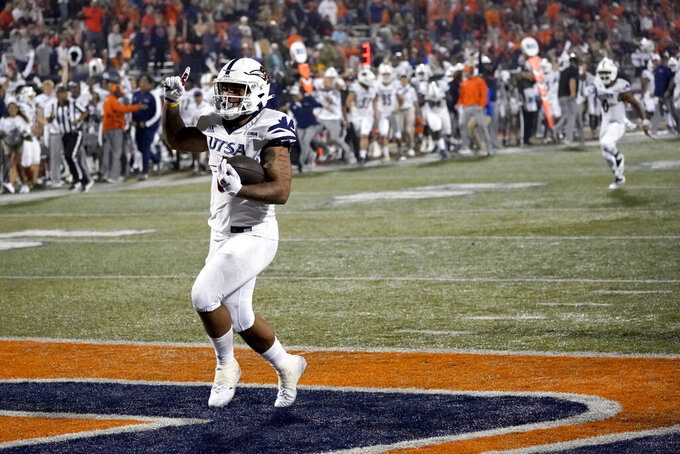 UTSA running back Brendon Brady celebrates his touchdown run during the second half of an NCAA college football game against Illinois, Saturday, Sept. 4, 2021, in Champaign, Ill. (AP Photo/Charles Rex Arbogast)