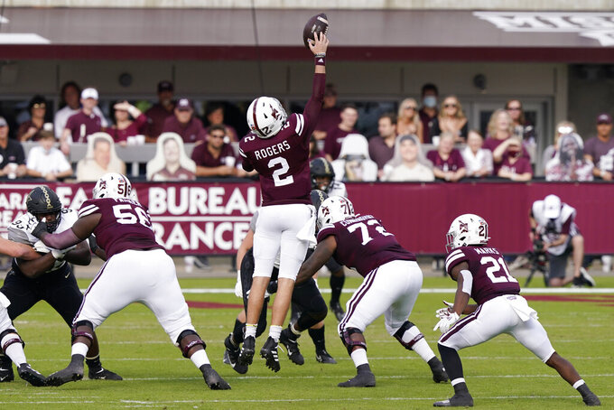 Mississippi State quarterback Will Rogers (2) reaches for a high snap against Vanderbilt during the first half of an NCAA college football game in Starkville, Miss., Saturday, Nov. 7, 2020. (AP Photo/Rogelio V. Solis)