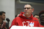 Chicago Teachers Union President Jesse Sharkey answers reporters' questions after a meeting of the CTU House of Delegates, at the CTU Center, Wednesday, Oct. 16, 2019, in Chicago. Chicago parents and community groups are scrambling to prepare for a massive teachers' strike set to begin Thursday, prompting the city to preemptively cancel classes in the nation's third-largest school district. (John J. Kim/Chicago Tribune via AP)