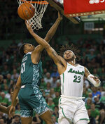 Marshall's Rondale Watson (23) attempts a layup against Green Bay's Jayquan McCloud (11) in the championship game of the CollegeInsider.com Tournament on Thursday, April 4, 2019, in Huntington, W.Va.  (Sholten Singer/The Herald-Dispatch via AP)