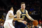 Michigan forward Ignas Brazdeikis, right, of Canada, drives against Maryland guard Anthony Cowan Jr. in the first half of an NCAA college basketball game, Sunday, March 3, 2019, in College Park, Md. (AP Photo/Patrick Semansky)