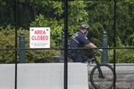 A U.S. Capitol Police officer patrols the barricaded perimeter of the Capitol grounds in Washington, Monday, June 14, 2021. (AP Photo/J. Scott Applewhite)