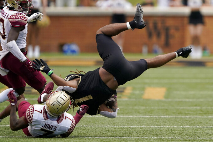 Wake Forest running back Christian Beal-Smith is tackled by Florida State defensive back Jarrian Jones during the second half of an NCAA college football game Saturday, Sept. 18, 2021, in Winston-Salem, N.C. (AP Photo/Chris Carlson)