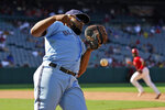 Toronto Blue Jays first baseman Vladimir Guerrero Jr. commits a fielding error allowing two runs to score on a fly ball from Los Angeles Angels' Jo Adell during the fifth inning in the first baseball game of a doubleheader Tuesday, Aug. 10, 2021, in Anaheim, Calif. (AP Photo/Marcio Jose Sanchez)