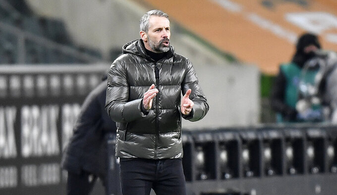 Moenchengladbach's head coach Marco Rose reacts during the German Bundesliga soccer match between Borussia Moenchengladbach and Borussia Dortmund in Moenchengladbach, Germany, Friday, Jan. 22, 2021. (AP Photo/Martin Meissner, Pool)