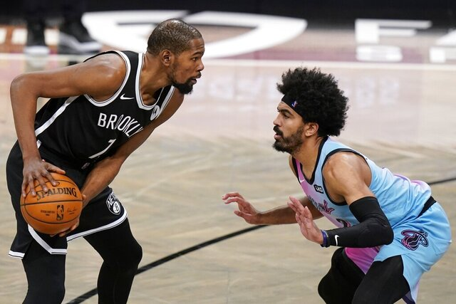 Miami Heat's Gabe Vincent (2) defends against Brooklyn Nets' Kevin Durant (7) during the second half of an NBA basketball game Saturday, Jan. 23, 2021, in New York. (AP Photo/Frank Franklin II)