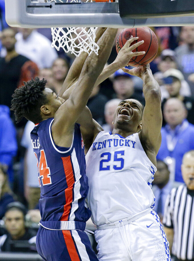 Kentucky's PJ Washington (25) heads to the basket as Auburn's Anfernee McLemore (24) defends during overtime of the Midwest Regional final game in the NCAA men's college basketball tournament Sunday, March 31, 2019, in Kansas City, Mo. Auburn won 77-71. (AP Photo/Charlie Riedel)