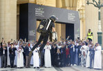 British inventor Richard Browning uses a jet pack to display his technology at the Future Investment Initiative forum in Riyadh, Saudi Arabia, Tuesday, Oct. 29, 2019. The long-planned initial public offering of a sliver of Saudi Arabia's state-run oil giant Saudi Aramco will see shares traded on Riyadh's stock exchange in December, a Saudi-owned satellite news channel reported Tuesday as the kingdom's marquee investment forum got underway. (AP Photo/Amr Nabil)