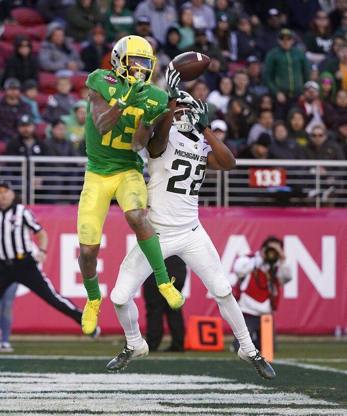 Michigan State cornerback Josiah Scott (22) breaks up a pass for Oregon wide receiver Dillon Mitchell (13) during the second half of the Redbox Bowl NCAA college football game Monday, Dec. 31, 2018, in Santa Clara, Calif. Oregon won 7-6. (AP Photo/Tony Avelar)