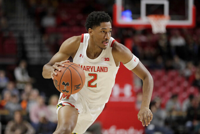 Maryland guard Aaron Wiggins drives to the basket against Rhode Island during the first half of an NCAA college basketball game, Saturday, Nov. 9, 2019, in College Park, Md. (AP Photo/Julio Cortez)