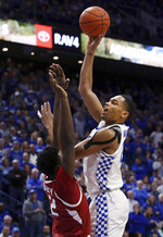 Kentucky's PJ Washington, right, shoots while pressured by Arkansas' Adrio Bailey during the second half of an NCAA college basketball game in Lexington, Ky., Tuesday, Feb. 26, 2019. Kentucky won 70-66. (AP Photo/James Crisp)