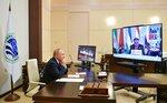 Russian President Vladimir Putin takes part in the Shanghai Cooperation Organization (SCO) meeting in Dushanbe, Tajikistan via videoconference at the Novo-Ogaryovo residence outside Moscow, Russia, Friday, Sept. 17, 2021. Tajikistan President Imomali Rakhmon is on the screen. (Alexei Druzhinin, Sputnik, Kremlin Pool Photo via AP)