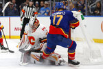 St. Louis Blues' Jaden Schwartz (17) is unable to score past Calgary Flames goaltender David Rittich, of the Czech Republic, during the second period of an NHL hockey game Thursday, Nov. 21, 2019, in St. Louis. (AP Photo/Jeff Roberson)