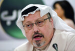 FILE - In this Dec. 15, 2014 file photo, Saudi journalist Jamal Khashoggi speaks during a press conference in Manama, Bahrain.  United Nations experts Wednesday, Jan. 22, 2020 called for an