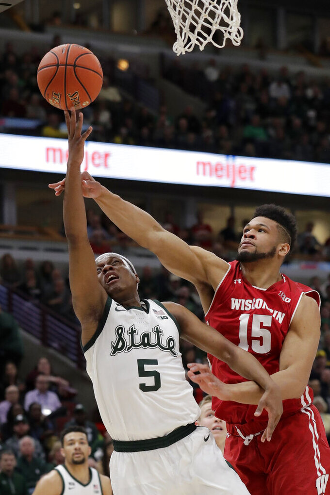Michigan State's Cassius Winston (5) shoots against Wisconsin's Charles Thomas IV (15) during the second half of an NCAA college basketball game in the semifinals of the Big Ten Conference tournament, Saturday, March 16, 2019, in Chicago. (AP Photo/Nam Y. Huh)