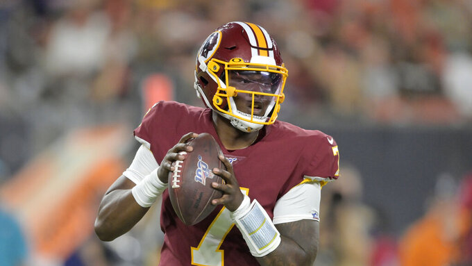 Washington Redskins quarterback Dwayne Haskins looks to pass during the first half of the team's NFL preseason football game against the Cleveland Browns, Thursday, Aug. 8, 2019, in Cleveland. (AP Photo/David Richard)