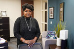 "Lisa Rice, President and CEO of the National Fair Housing Alliance, poses for a photo in her office, Wednesday, Oct. 28, 2020, in Washington. Several fair housing organizations accused Redfin of systematic racial discrimination in a lawsuit filed Oct. 29, saying the online real estate broker offers fewer services to homebuyers and sellers in minority communities _ a type of ""digital redlining"" that has depressed home values and exacerbated historic injustice in the housing market. (AP Photo/Patrick Semansky)"