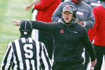 Nebraska head coach Scott Frost complains to side judge Todd Ransom during the first half of an NCAA college football game against Minnesota in Lincoln, Neb., Saturday, Dec. 12, 2020. (AP Photo/Nati Harnik)