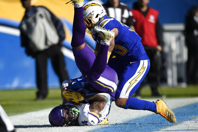 Minnesota Vikings tight end Irv Smith holds on to the pass for a touchdown as Los Angeles Chargers free safety Derwin James defends during the first half of an NFL football game Sunday, Dec. 15, 2019, in Carson, Calif. (AP Photo/Kelvin Kuo)