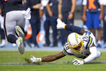 Houston Texans running back Duke Johnson, left, breaks away from Los Angeles Chargers defensive back Brandon Facyson during the first half of an NFL football game Sunday, Sept. 22, 2019, in Carson, Calif. (AP Photo/Mark J. Terrill)