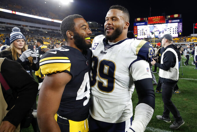 Pittsburgh Steelers running back Tony Brooks-James, left, and Los Angeles Rams defensive tackle Aaron Donald (99) visit on the field following an NFL football game in Pittsburgh, Sunday, Nov. 10, 2019. The Steelers won 17-12. (AP Photo/Don Wright)