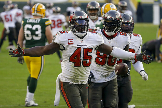 Tampa Bay Buccaneers' Devin White (45) celebrates after picking up a fumble by Green Bay Packers' Aaron Jones (33) after being hit by Tampa Bay Buccaneers' Jordan Whitehead (33) during the second half of the NFC championship NFL football game in Green Bay, Wis., Sunday, Jan. 24, 2021. (AP Photo/Mike Roemer)