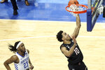 South Carolina's Justin Minaya (10) shoots in front of Kentucky's Isaiah Jackson (23) during the first half of an NCAA college basketball game in Lexington, Ky., Saturday, March 6, 2021. (AP Photo/James Crisp)