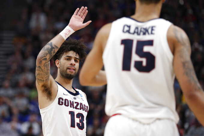 Gonzaga guard Josh Perkins (13) looks to high-five forward Brandon Clarke (15) during the first half against Baylor in a second-round game in the NCAA men's college basketball tournament Saturday, March 23, 2019, in Salt Lake City. (AP Photo/Jeff Swinger)