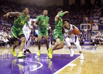 Washington guard David Crisp, right, is blocked by Oregon guard Will Richardson, second from right, as Oregon's Kenny Wooten (14) and Louis King, (2) watch during the first half of an NCAA college basketball game, Saturday, March 9, 2019, in Seattle. (AP Photo/Ted S. Warren)
