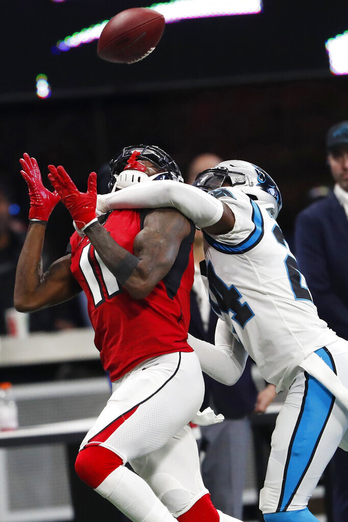 Atlanta Falcons wide receiver Julio Jones (11) prepares to make the catch ahead of Carolina Panthers cornerback James Bradberry (24) during the first half of an NFL football game, Sunday, Dec. 8, 2019, in Atlanta. (AP Photo/John Bazemore)