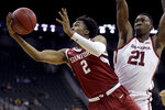 Stanford guard Bryce Wills (2) gets past Oklahoma forward Kristian Doolittle (21) to put up a shot during the second half of an NCAA college basketball game Monday, Nov. 25, 2019, in Kansas City, Mo. Stanford won 73-54. (AP Photo/Charlie Riedel)