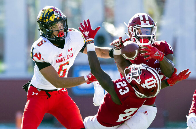 Indiana defensive back Jaylin Williams (23) and defensive back Marcelino Ball (42) battle to grab a pass intended for Maryland wide receiver Jeshaun Jones (6) during the first half of an NCAA college football game Saturday, Nov. 10, 2018, in Bloomington, Ind. (AP Photo/Doug McSchooler)