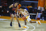 Tennessee's Jaden Springer (11) moves the ball against Georgia's Toumani Camara (10) during an NCAA college basketball game Wednesday, Feb. 10, 2021, in Knoxville, Tenn., in Knoxville, Tenn. (Randy Sartin/Pool Photo via AP)