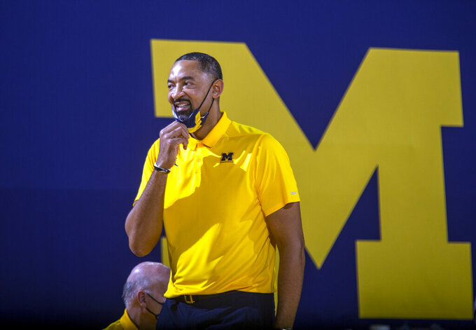 Michigan head coach Juwan Howard reacts courtside in the second half of an NCAA college basketball game against Minnesota at Crisler Center in Ann Arbor, Mich., Wednesday, Jan. 6, 2021. (AP Photo/Tony Ding)