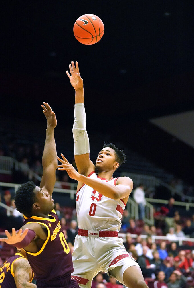 Stanford forward KZ Okpala (0) shoots over Arizona State guard Luguentz Dort (0) during the first half of an NCAA college basketball game in Stanford, Calif., Saturday, Jan. 12, 2019. (AP Photo/Tony Avelar)